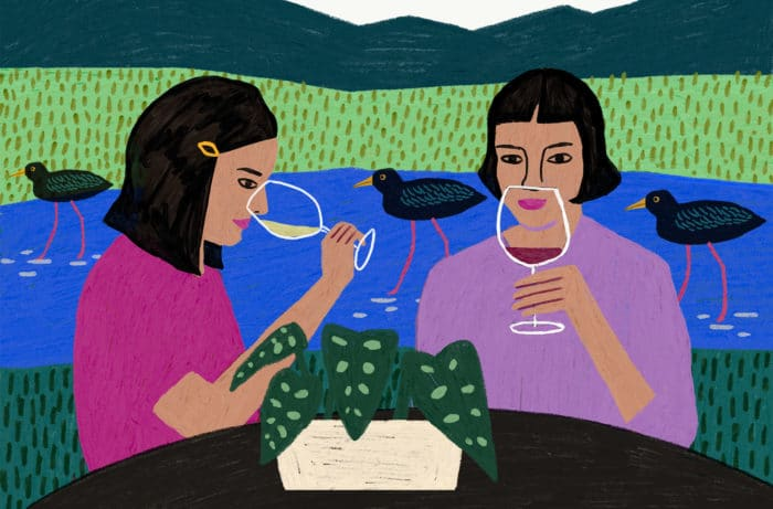 Image by Anne Bentley of two women drinking wine